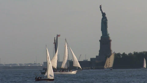 Sailboats pass in front of the Statue Of Liberty i Footage