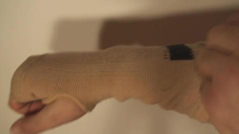 Man Putting Wrist Guard On His Hand, Wrist Pain, I Footage
