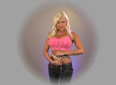 Beautiful Blonde Measures Her Waist (1) Stock Video Footage