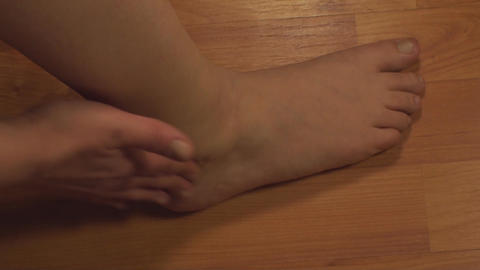Woman Massaging Ankle, Ankle Injury, Pain, Treatme Live Action