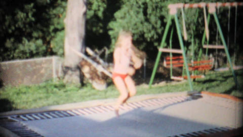 Girl Jumping On In Ground Trampoline 1967 Vintage stock footage