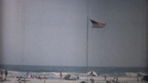 US Flag Flies Proudly At Florida Beach 1967 stock footage