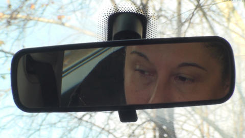 Adult Woman Looks Into Rearview Mirror And Waits Footage