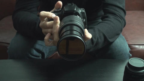 Young Man Tries Out A New DSLR Camera Front Footage