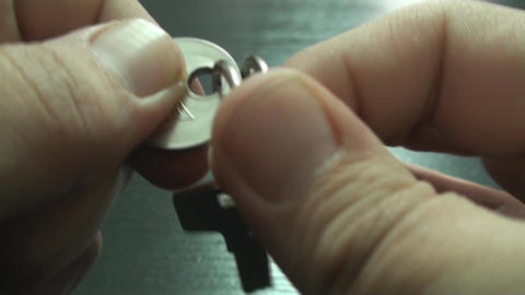 Young Male Removes A Key From The Keychain Point O Live Action