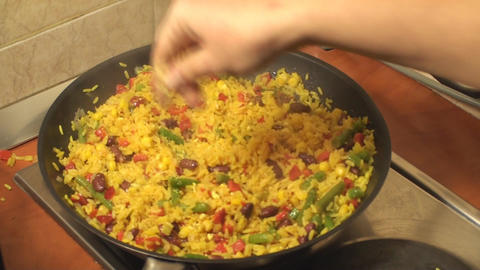 Mexican Rice Cooking In The Frying Pan And Adding  Footage