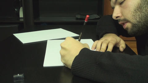 Young Man Drawing On Paper With A Pencil Side Shot stock footage