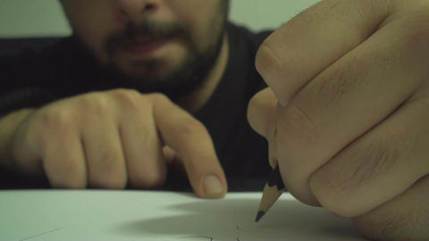 Young Man Drawing On Paper With A Pencil Front Sho Footage