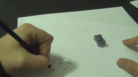 Young Man Drawing On Paper With A Pencil Above Sho Footage