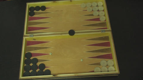 Young Man Throws The Dice in A Backgammon Game Abo Footage