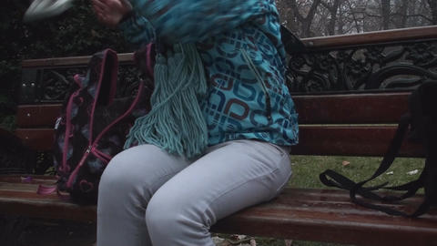 Young Woman Unpacks Her's Ice Skates In The Park Live Action