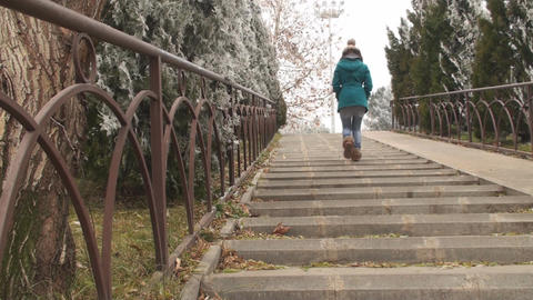 Young Woman Walks Slowly Down The Stairs In The Pa Footage
