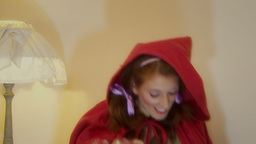 Christmas Little Red Riding Hood choosing decorati Footage