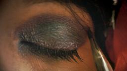 Eye macro woman apply make up long Footage