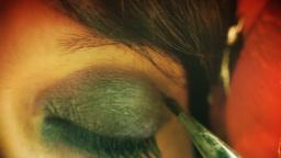 Eye macro woman apply make up retro Footage