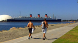 Father Son Walk With Queen Mary In Background stock footage