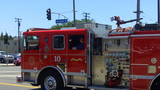 Fire Engine Moving Through Busy Intersection stock footage