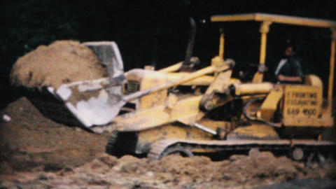 Bulldozer Moving Dirt On Construction Site 1967 stock footage