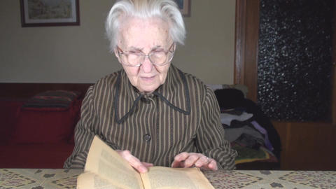 Old Lady Reading An Old Book Front-Shot stock footage