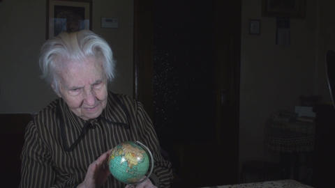 Old Lady Looking On An Earth Mini Globe Live Action