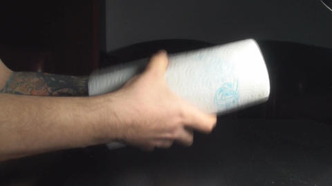 Young Male Rips A Paper Towel Point Of Side-Shot Footage