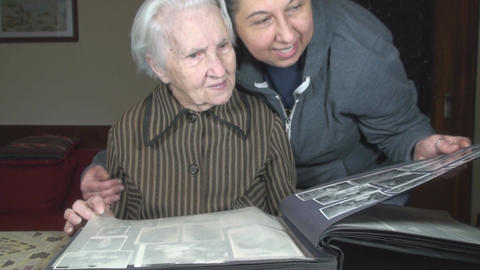 Old Lady And Her Grand Daughter Going Through Fami Live Action
