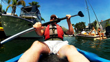 Mature Man Kayaking Past Yachts Boats stock footage