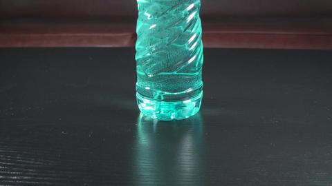 Bottle Of Water Tilt-Shot Footage