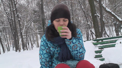 Cute Young Female Enjoys A Nice Cup Of Hot Coco Fr stock footage