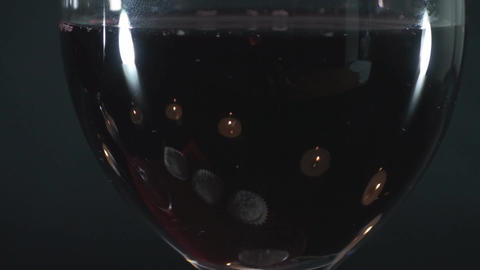Glass Of Wine Detail Of Lit Small Candles Macro Footage