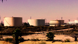 Old Oil Storage Tanks At Petroleum Refinery stock footage