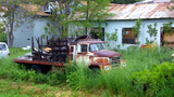 Old Truck In Rundown Area Of Mountain Town stock footage