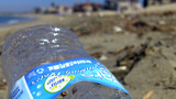 Plastic Bottle Trash On Ocean Beach XCU 1 stock footage