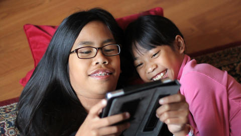 Girl Enjoy Spending Time With Big Sister On Tablet Footage
