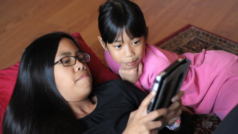 Girls Playing Games On New Digital Tablet Footage