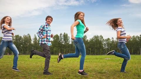 Teens Having Fun on the Meadow (looped) Footage