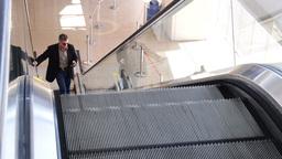 Businessman on Escalator Footage