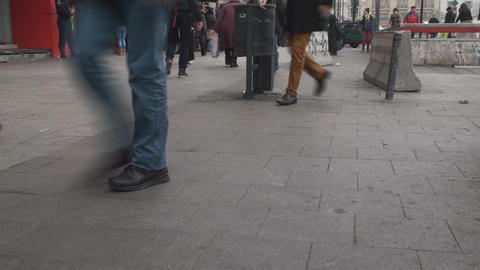 People Walking By On A Friday Morning Still-Shot Footage