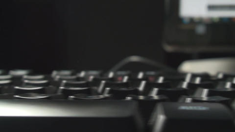 Illuminated Keyboard Close-Up Dolly-Shot Footage