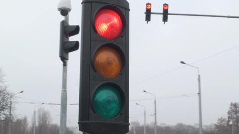 Traffic Lights Red Turns Green For Cars Still-Shot Footage