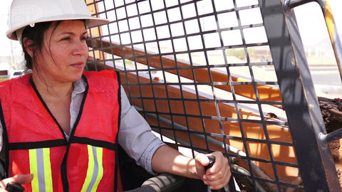 Industrial Female On Skid-steer Smile stock footage