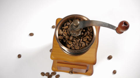 Old Wooden Worm Eaten Coffee Mill Isolated On A Wh stock footage