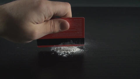 Hand Making Cocaine Lines With A Credit Card Footage