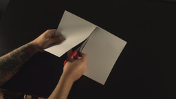 Hands Cutting Paper Above-Shot stock footage