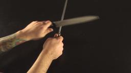 Hands Sharpening Knife Above-Shot Footage