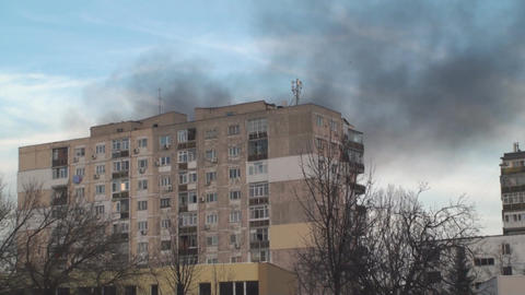 Apartment Blocks On Fire Smoke Rising Tilt-Shot stock footage