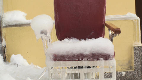 Frozen Barber Shop Chair Full With Ice Tilt-Shot stock footage