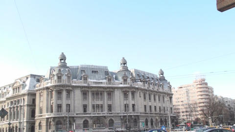 University Of Bucharest With Traffic Pan-Shot stock footage
