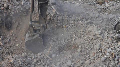 Excavator bucket working on pile of debris Footage