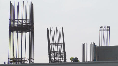 Construction Site With A Worker Climbing Down From Footage